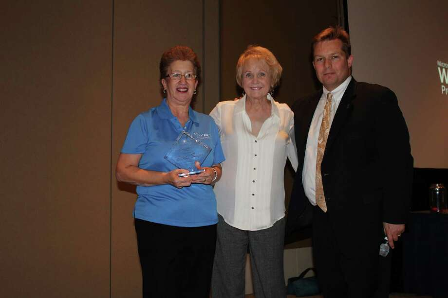 Gloria Reyes, left, of the Fort Bend County District Attorney's Office, with award namesake, Carol Rees, and Assistant District Attorney Chad Bridges. Photo: Fort Bend County Attorney's Office Photo