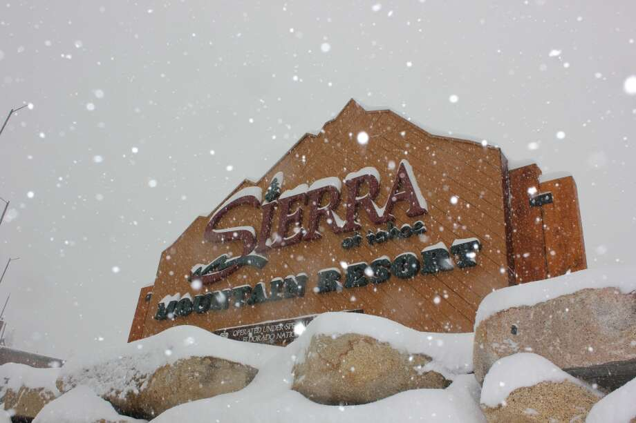Snow falling on the Sierra-at-Tahoe sign. Photo: Jules Older, The Chronicle