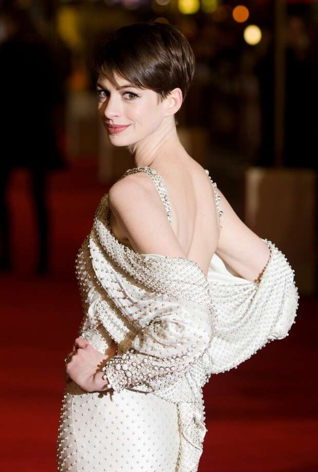 "Actress Anne Hathaway embraces her new short cut on the red carpet ahead of the world premiere of ""Les Miserables"" in central London. Photo: Leon Neal, AFP/Getty Images"