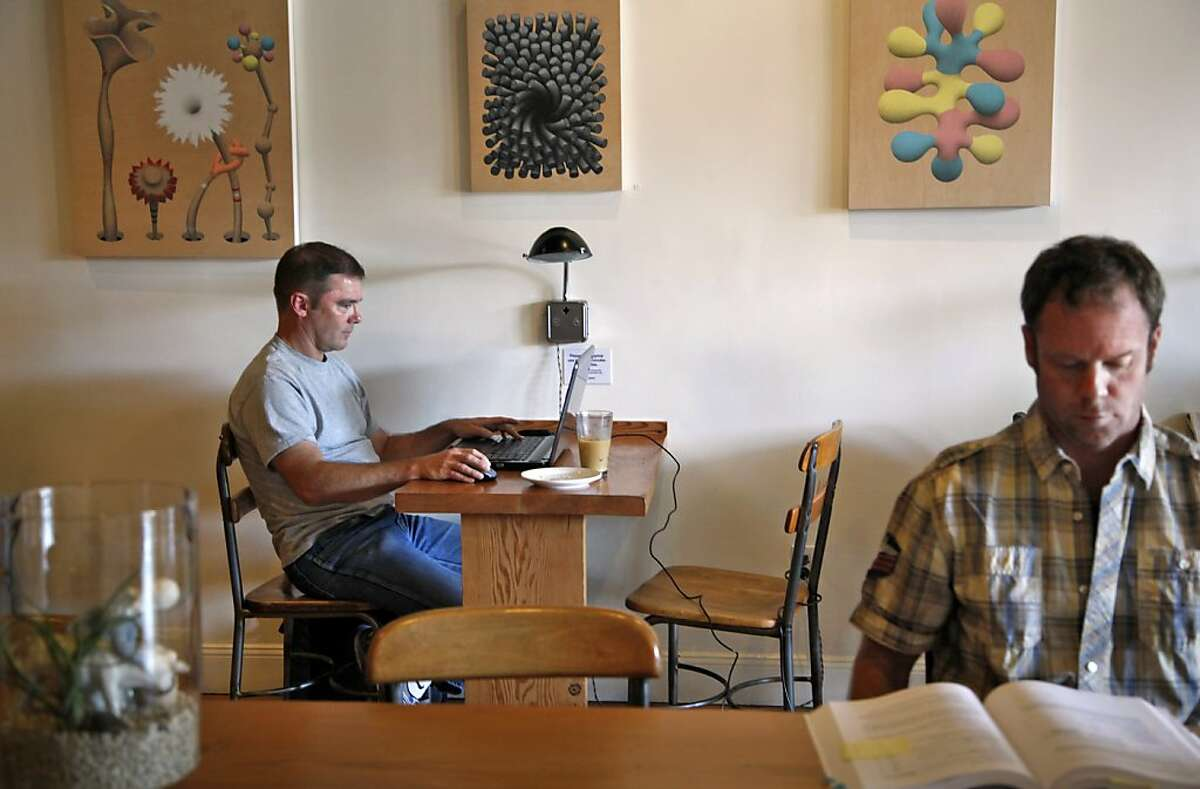 Aaron Kerry (left) works at Acre Coffee in Petaluma, Calif., on Wednesday, October 23, 2013.