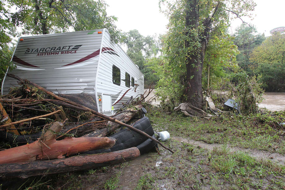 An RV trailer is nestled downstream from the River Ranch RV Resort after the Guadalupe River and Comal rivers flow over their banks in New Braunfels  on October 31, 2013. Photo: TOM REEL
