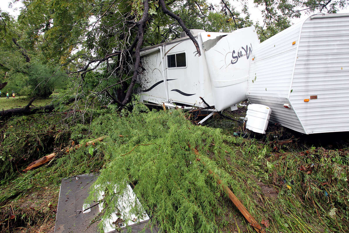 A pair of RV trailers jammed in against trees downstream from the River Ranch RV Resort after the Guadalupe River and Comal rivers flow over their banks in New Braunfels on October 31, 2013.