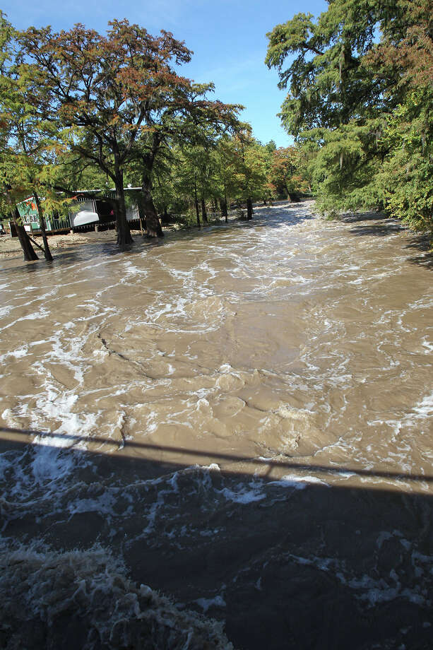 Water rushes through Gruene as the Guadalupe River and Comal rivers flow over their banks in New Braunfels  on October 31, 2013. Photo: TOM REEL