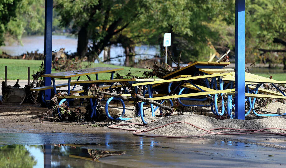 Benches near the Gruene crossing are covered with debris as the Guadalupe River and Comal rivers flow over their banks in New Braunfels  on October 31, 2013. Photo: TOM REEL