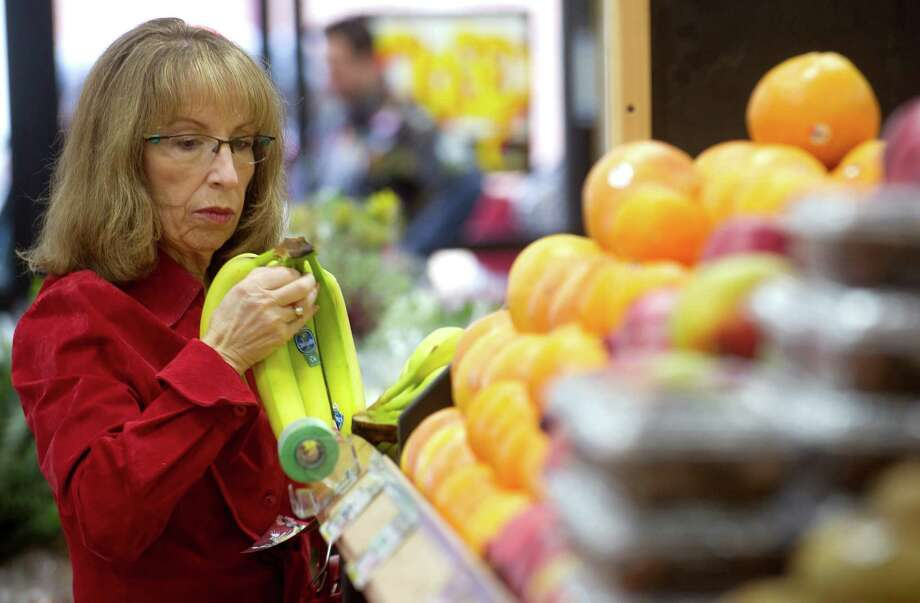 Linda Rothman shops in the new Trader Joe's during their grand opening on High Ridge Road in Stamford, Conn., on Thursday, October 31, 2013. Rothman said she regularly shops in the Darien Trader Joe's, but now will do her shopping closer to home in Stamford. Photo: Lindsay Perry / Stamford Advocate
