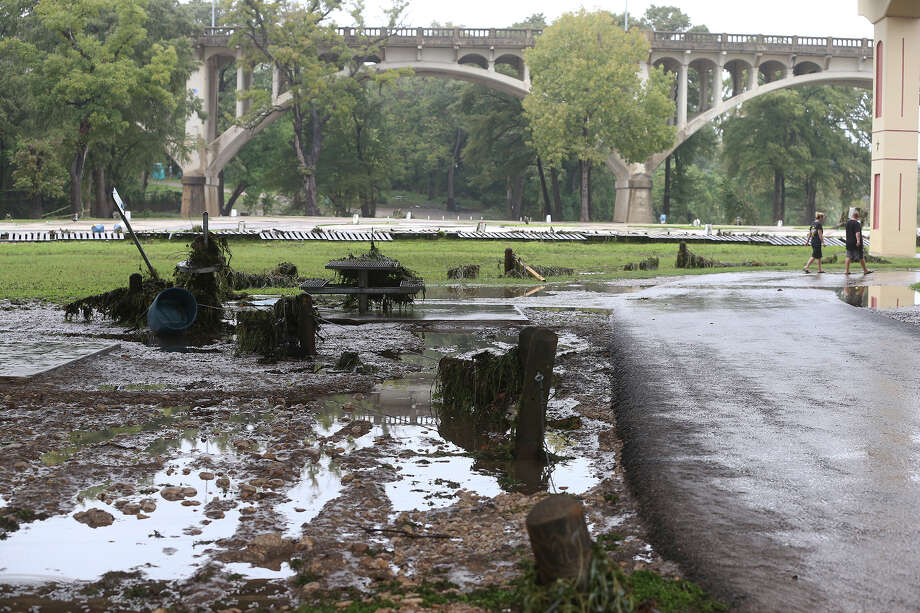 Debris litters the park under the I35 bridges after the Guadalupe River and Comal rivers flow over their banks in New Braunfels  on October 31, 2013. Photo: TOM REEL