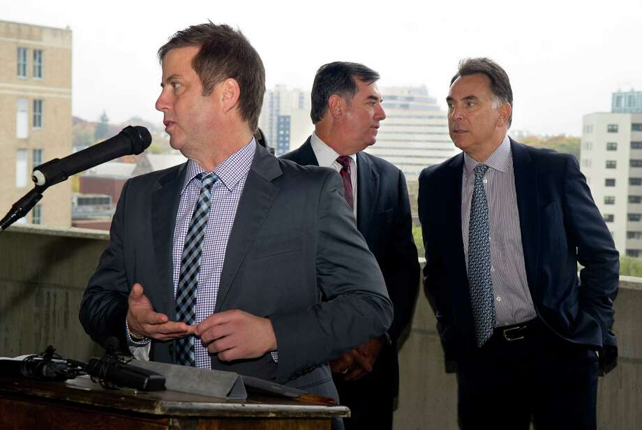 David Barry of Ironstate Development speaks as Mayor Michael Pavia, center, talks with Tom Rich, right, during a press conference on Oct. 31, 2013 to announce a development deal has been reached for the downtown site in Stamford, Conn.. Photo: Lindsay Perry / Stamford Advocate