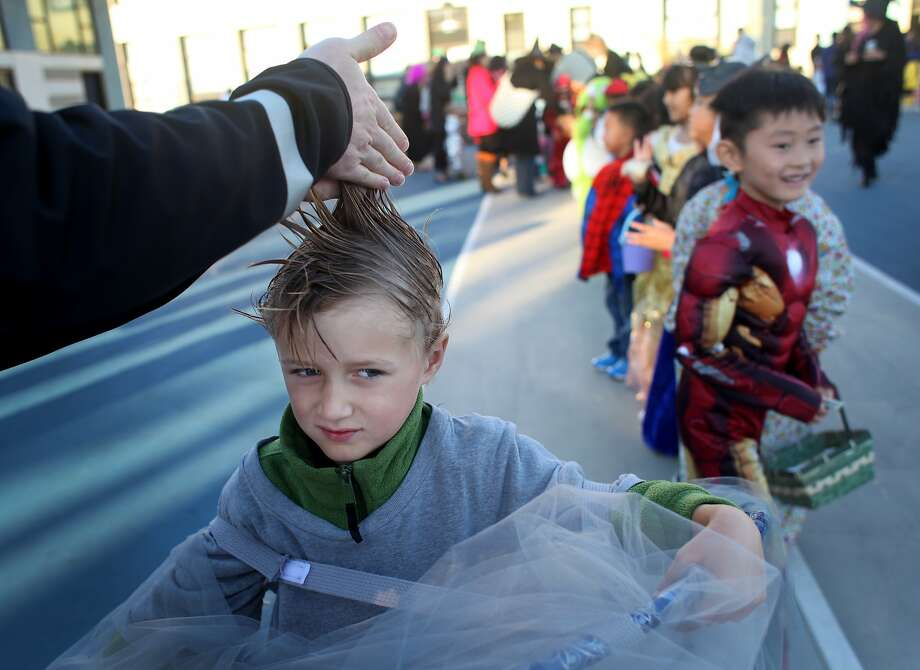Dallas Wisehaupt works his son Otis Tripp Wisehaupt's, 6, hair just before the annual halloween parade at Francis Scott Key Elementary School in San Francisco, Calif., Thursday, October 31, 2013. Otis, a first grader, went as a tornado. Photo: Judy Walgren, SFC