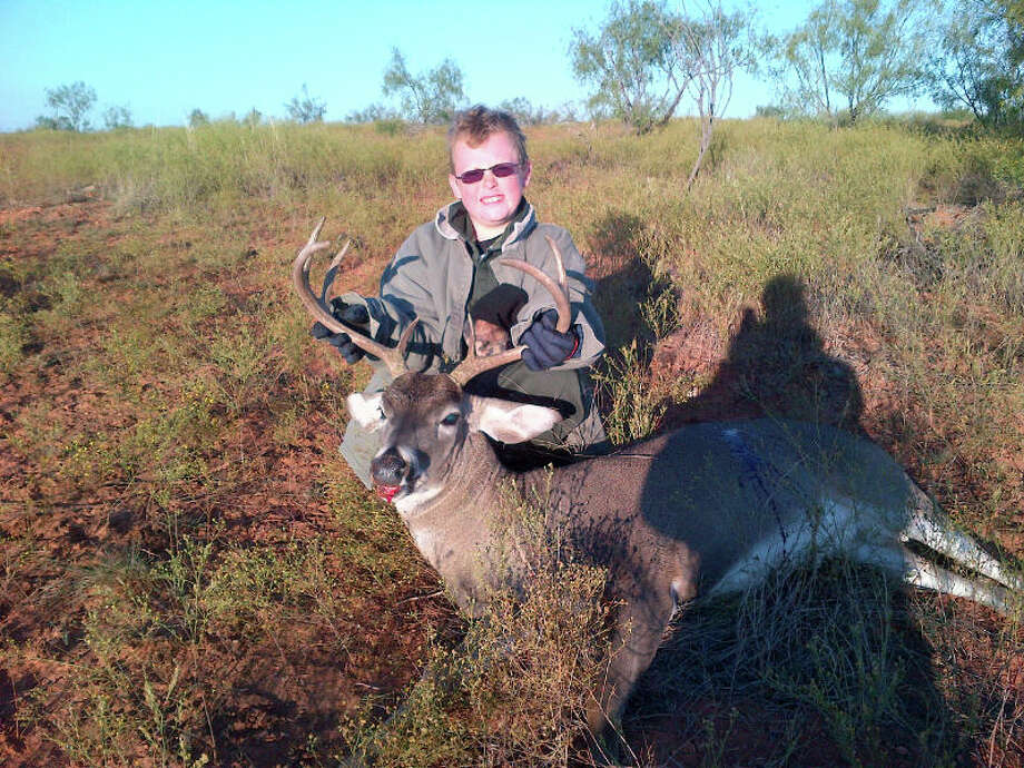 10-year-old Ethan Carter with his first deer near Jayton, Texas. Photo: Reader Submission