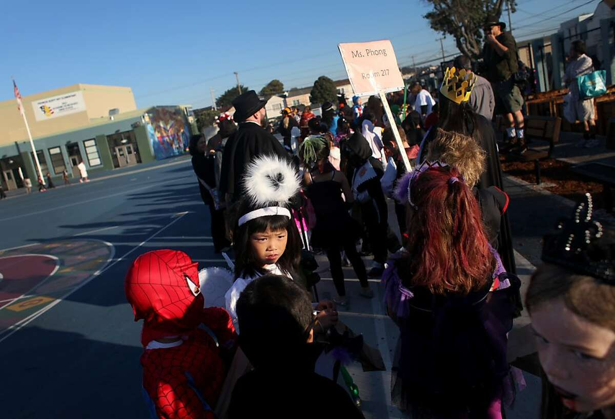 Second trade student Mayu Yamasaki, 7, dressed as an angel for the annual halloween parade at Francis Scott Key Elementary School in San Francisco, Calif., Thursday, October 31, 2013.