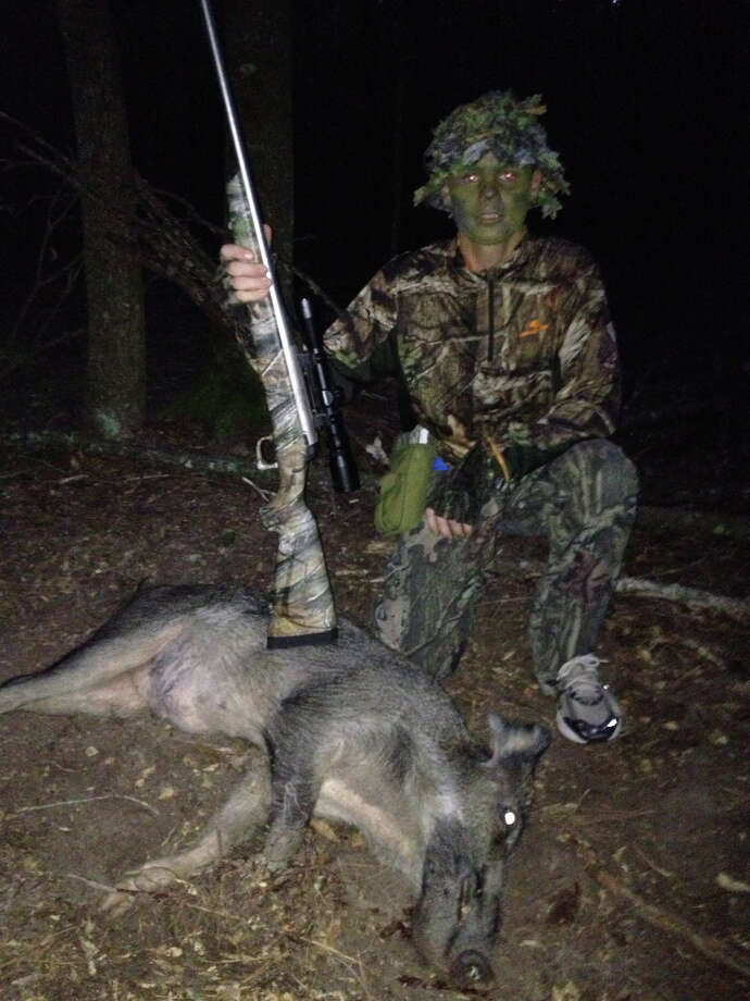 A 14-year-old hog hunter, sent in by Scott Blankenship. Photo: Reader Submission