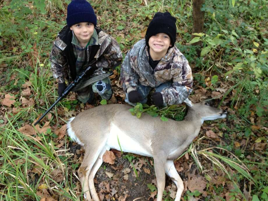 Corey Rogers, 9, with his first deer and his 6-year-old brother Cameron in Dayton. Photo: Reader Submission
