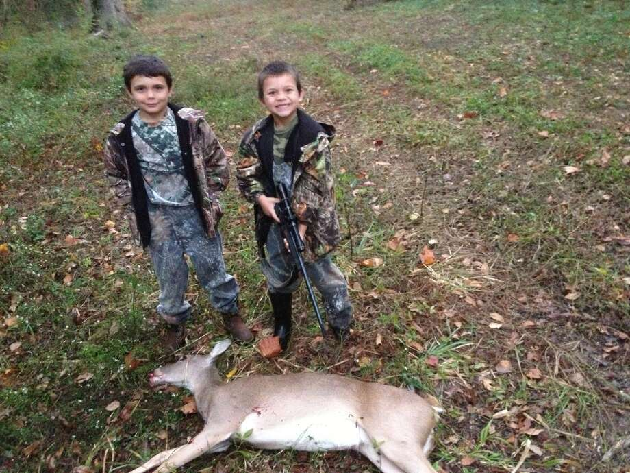 Corey Rogers, 6, in Dayton with his first deer and his older brother, 9-year-old Cameron. Photo: Reader Submission