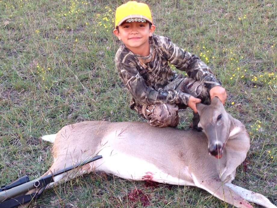 Josh Olivio, 7 in Lampasas, Texas. This is his second hunt and his third deer. Photo: Reader Submission