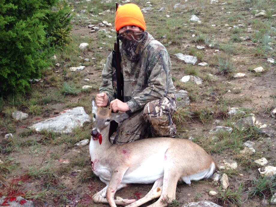 Robert Gamez, 16, with his second deer on his second hunt in Lampasas, Texas.  Photo: Reader Submission