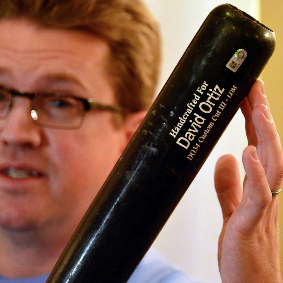 Brad Horn, director of education at the Baseball Hall of Fame, holds David Ortiz's bat from game 5 of the 2013 World Series. Artifacts are en route to Cooperstown on Thursday, Oct. 31, 2013. The artifacts were displayed during a news conference at the Desmond Hotel in Colonie, N.Y. (John Carl D'Annibale / Times Union) Photo: John Carl D'Annibale / 00024461A