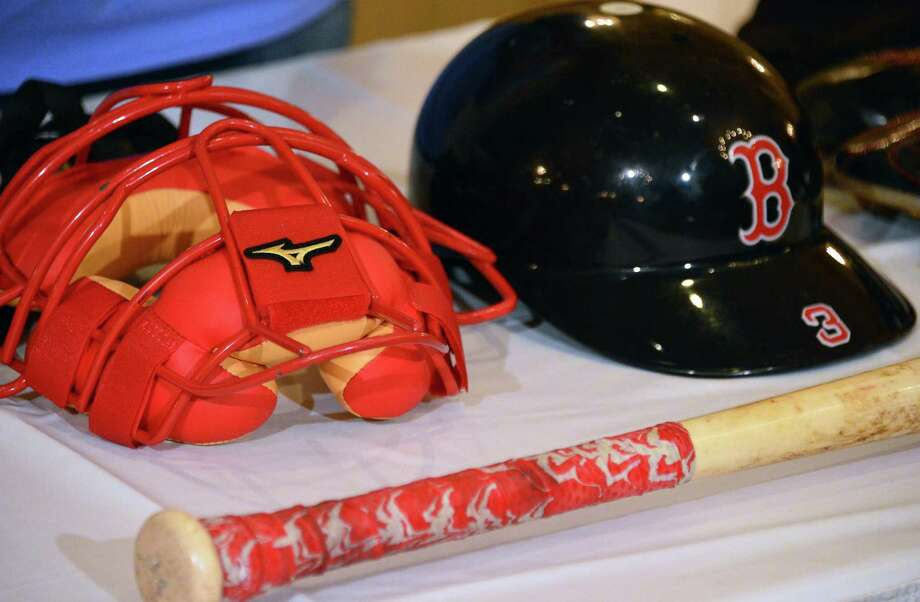 Catcher's mask and helmet from David Ross and David Ortiz's bat are among the 2013 World Series artifacts en route to the Baseball Hall of Fame during a news conference Thursday, Oct. 31, 2013, at the Desmond Hotel in Colonie, NY.  (John Carl D'Annibale / Times Union) Photo: John Carl D'Annibale / 00024461A