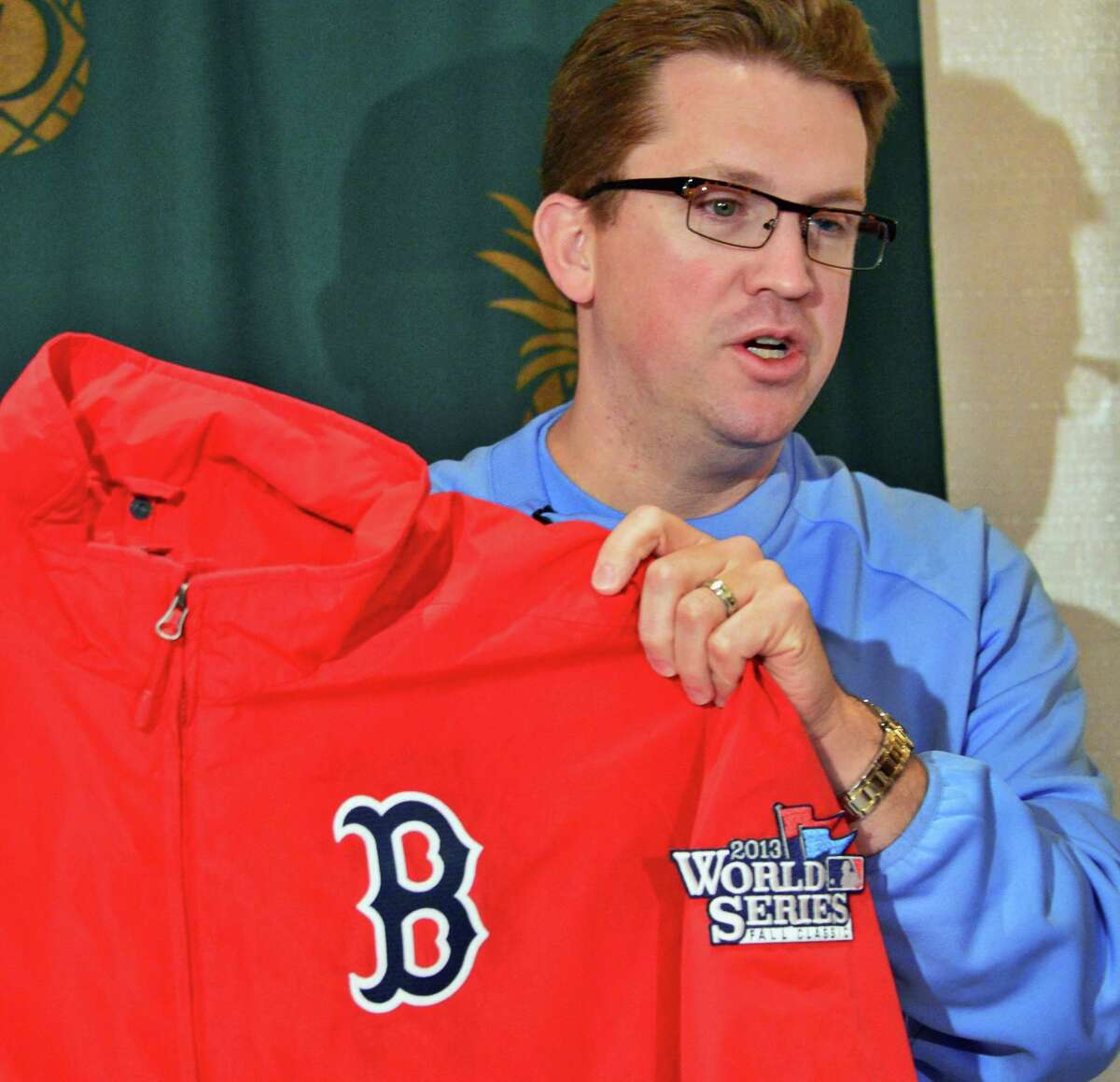 Brad Horn, director of education at the Baseball Hall of Fame, holds Red Sox manager John Farrell's jacket among the 2013 World Series artifacts en route to Cooperstown on Thursday Oct. 31, 2013. The artifacts were displayed during a news conference at the Desmond Hotel in Colonie, N.Y. (John Carl D'Annibale / Times Union)