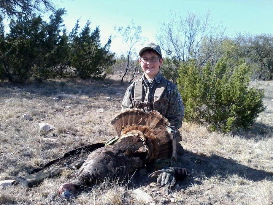 Will Tier, 12, of Pearland, with is first turkey in April 2013 on his Grandpa Bill's deer lease in Edwards County. Photo: Reader Submission
