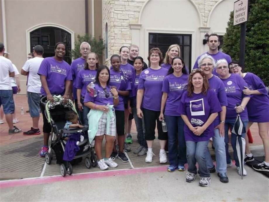 Staff members at The Village at Gleannloch Farms participated in the Walk to End Alzheimer's on Oct. 26 in Houston. Photo: Photo By The Village At Gleannloch Farms