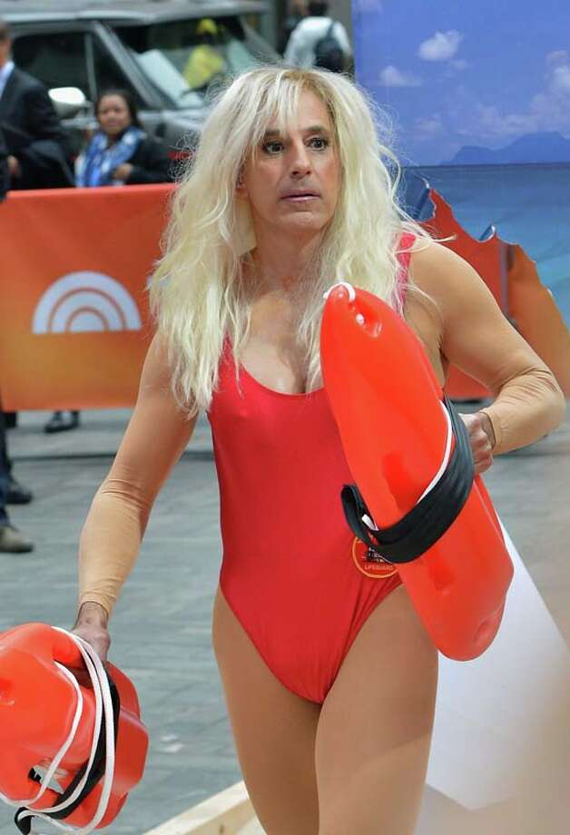 Matt Lauer, dressed as Pamela Anderson's 'Baywatch' character C. J. Parker  It only gets more ridiculous from here. Photo: Slaven Vlasic, Getty Images / 2013 Getty Images