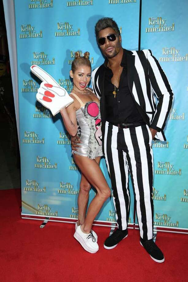 "Kelly Ripa and Michael Strahan attend ""LIVE With Kelly and Michael"": Best Halloween Show Ever Photo: Rob Kim, Getty Images / 2013 Getty Images"