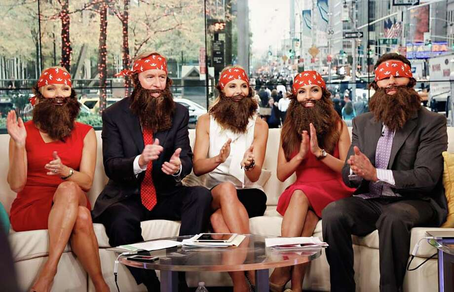 "Hosts Heather Childers, Steve Doocy, Elisabeth Hasselbeck, Brian Kilmeade and Maria Molina wear 'Duck Dynasty' costumes as ""FOX & Friends"" celebrates Halloween Photo: Cindy Ord, Getty Images / 2013 Getty Images"