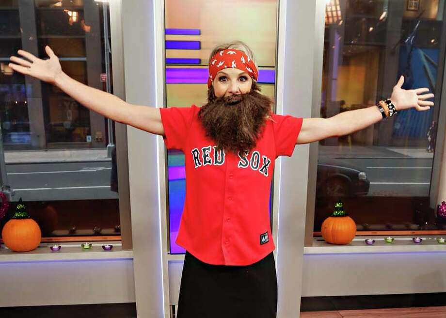 "Host Elisabeth Hasselbeck wears a 'Duck Dynasty' costume as ""FOX & Friends"" celebrates Halloween Photo: Cindy Ord, Getty Images / 2013 Getty Images"