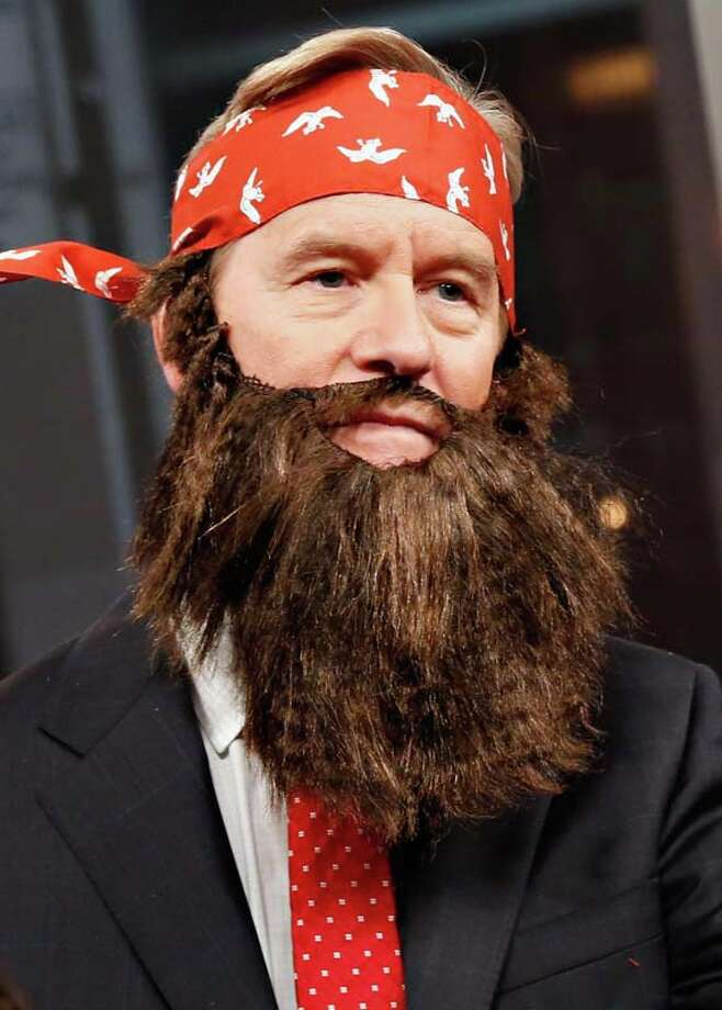 "Host Steve Doocy wears a 'Duck Dynasty' costume as ""FOX & Friends"" celebrates Halloween Photo: Cindy Ord, Getty Images / 2013 Getty Images"