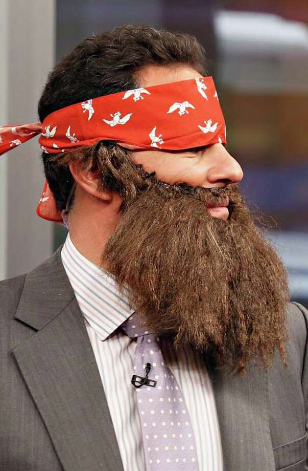 "Host Brian Kilmeade wears a 'Duck Dynasty' costume as ""FOX & Friends"" celebrates Halloween Photo: Cindy Ord, Getty Images / 2013 Getty Images"