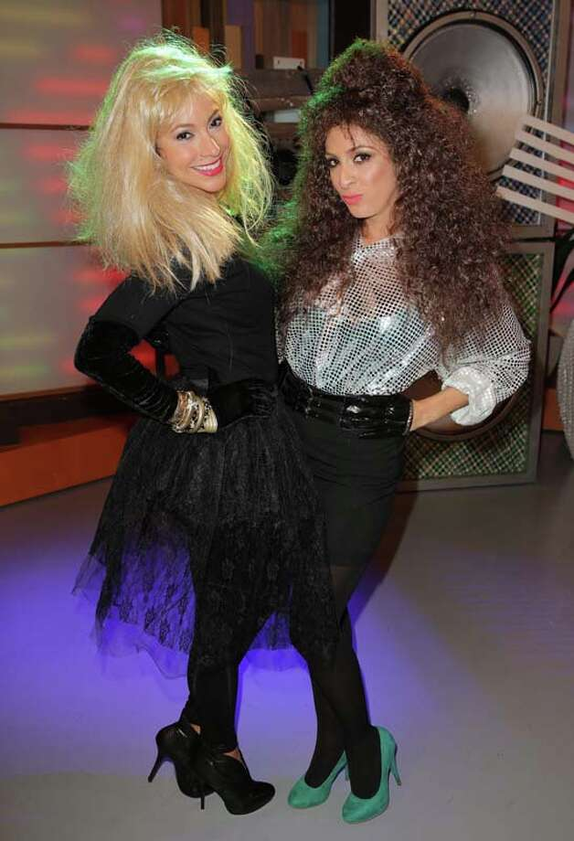 "Satcha Pretto and Maity Interiano celebrate Halloween on the set of Univisions ""Despierta America"" Photo: Alexander Tamargo, Getty Images / 2013 Alexander Tamargo"
