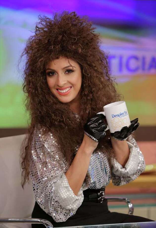 "Maity Interiano celebrates Halloween dressed as Amanda Miguel on the set of Univisions ""Despierta America"" Photo: Alexander Tamargo, Getty Images / 2013 Alexander Tamargo"