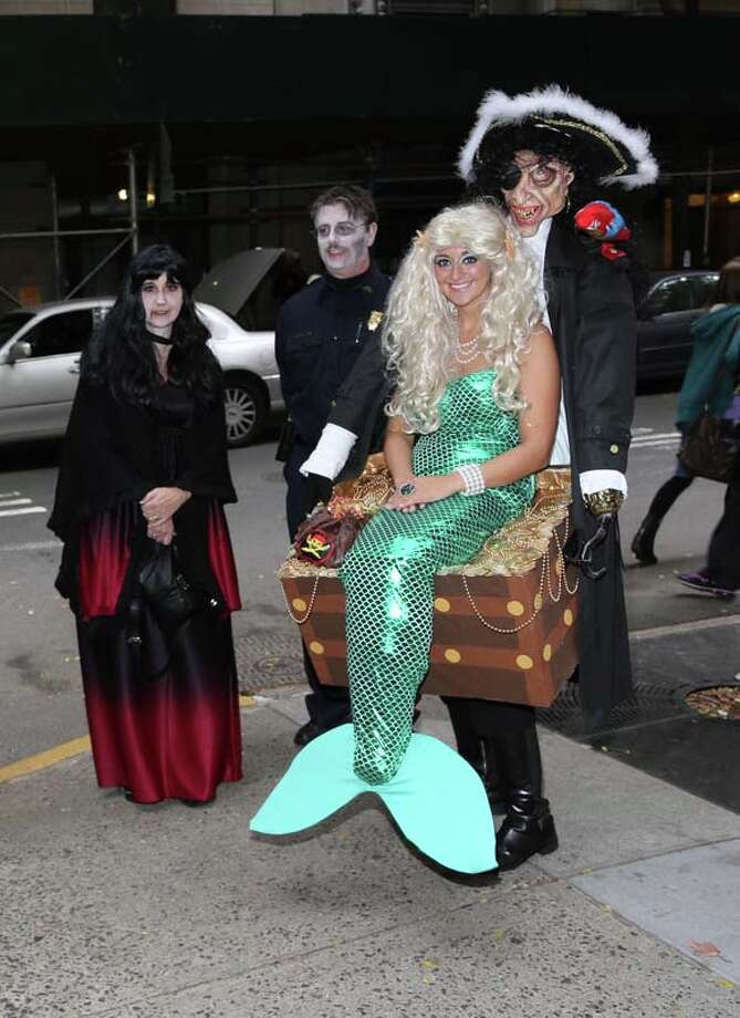 "Guests in costumes attend ""LIVE With Kelly and Michael"": Best Halloween Show Ever Photo: Rob Kim, Getty Images / 2013 Getty Images"