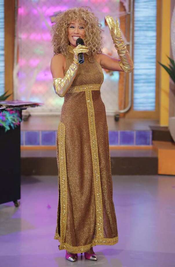"Karla Martinez celebrates Halloween dressed as Veronica Castro on the set of Univisions ""Despierta America"" Photo: Alexander Tamargo, Getty Images / 2013 Alexander Tamargo"