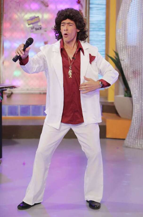 "Johnny Lozada celebrates Halloween dressed as El Puma on the set of Univisions ""Despierta America"" Photo: Alexander Tamargo, Getty Images / 2013 Alexander Tamargo"