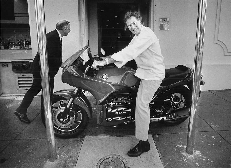 Jeremiah Tower outside his Stars restaurant with the new love of his life, a new BMW motorcycle he bought after taking full control of the restaurant. Photo: Brant Ward, The Chronicle