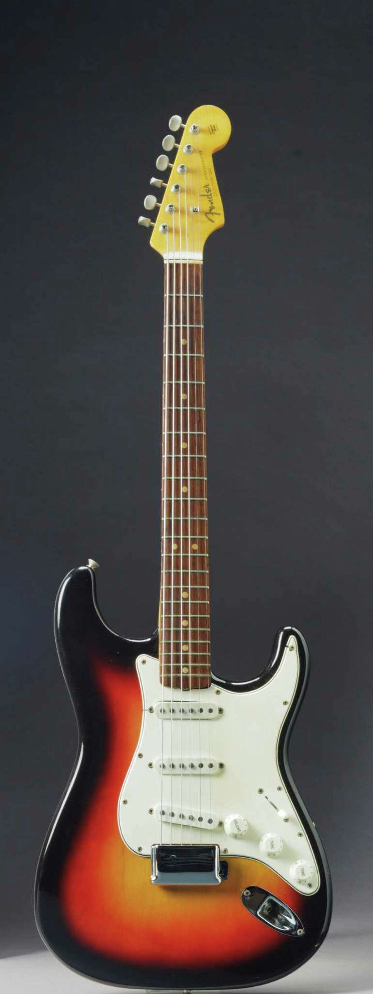 This undated photo provided by Christie's shows the Fender Stratocaster a young Bob Dylan played at the historic 1965 Newport Folk Festival. On Dec. 6, 2013, it could bring as much as half a million dollars when it comes up for auction at Christie's New York. The festival marked the first time Dylan went electric, a defining moment that marked his move from acoustic folk to electric rock and roll, drawing boos from folk-music purists. (AP Photo/Christie's) ORG XMIT: NY116