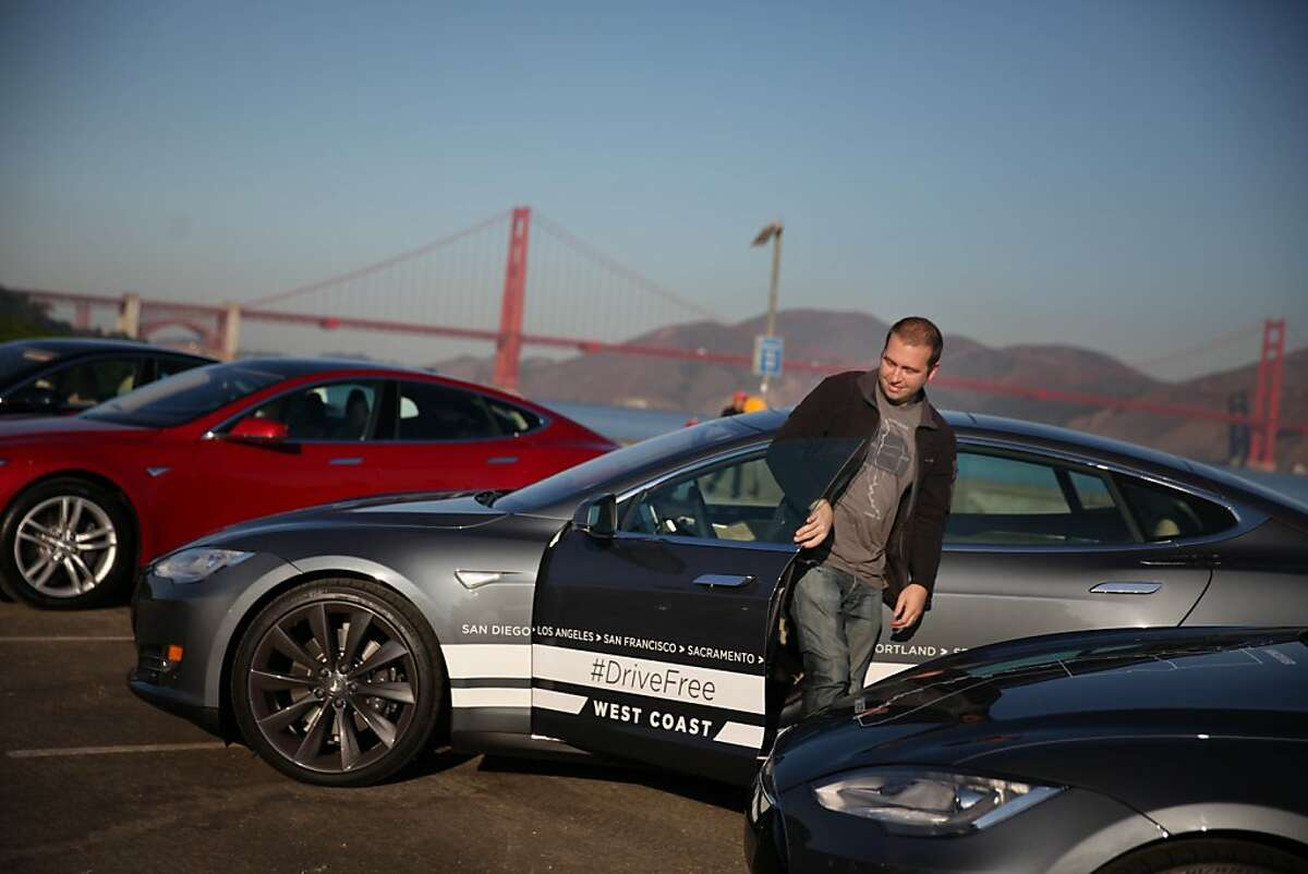 Daniel Myggen, Tesla sales operations, gets out of a Tesla Model S after parking it during a stop in San Francisco on a journey from San Diego to Vancouver powered only by Tesla Superchargers on Thursday, October 31, 2013 in San Francisco, Calif.