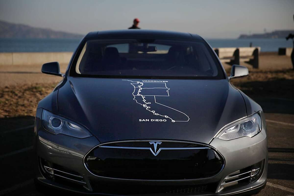 A graphic on the hood of a Tesla Model S shows the 13 supercharging stations the car will make as well as the start and finish points of a journey from San Diego to Vancouver powered only by Tesla Superchargers on Thursday, October 31, 2013 in San Francisco, Calif.