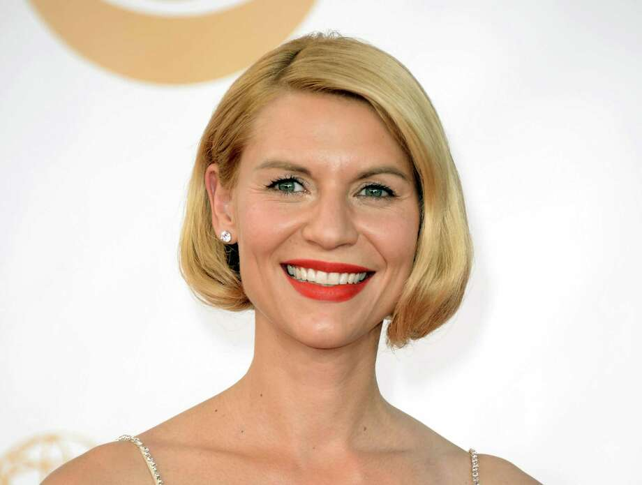 "FILe - This Sept. 22, 2013 file photo shows actress Claire Danes at the 65th Primetime Emmy Awards at Nokia Theatre in Los Angeles. Danes has been tapped to host the 20th anniversary Nobel Peace Prize concert in December. The Emmy-winning ""Homeland"" actress will host the Dec. 11 event in Oslo, Norway. (Photo by Dan Steinberg/Invision/AP, File) ORG XMIT: NYET347 Photo: Dan Steinberg / Invision"
