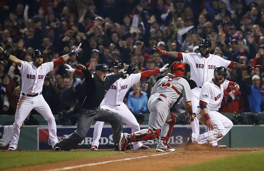 Five to one in favor of 'safe': Helpful Red Sox players assist umpire Jim Joyce with the call as Jonny Gomes slides safely home on Shane Victorino's three-run double. It was the key hit in the 6-1 victory over the Cards, giving Boston its third World Series championship in nine years. Photo: Elise Amendola, Associated Press
