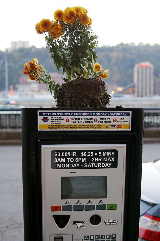 Meter mums: Unknown Pittsburgers beautified this parking pay station along Fort Pitt Boulevard. Photo: Keith Srakocic, Associated Press