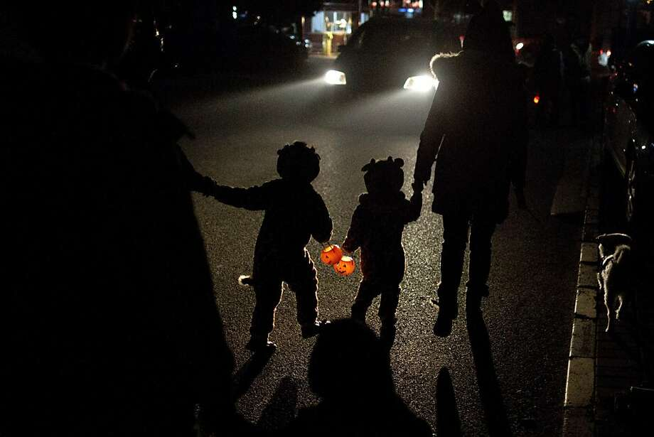In search of candy:Even Beijing has trick-or-treating. Photo: Alexander F. Yuan, Associated Press
