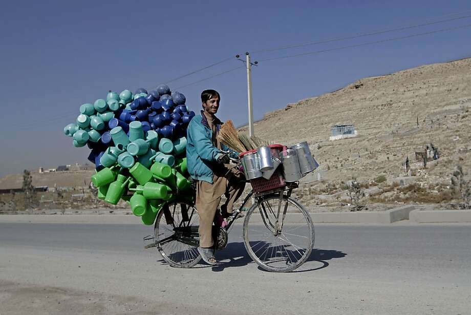 How many pitchers can a pitcher peddler pedal on the outskirts of Kabul, Afghanistan? Photo: Rahmat Gul, Associated Press