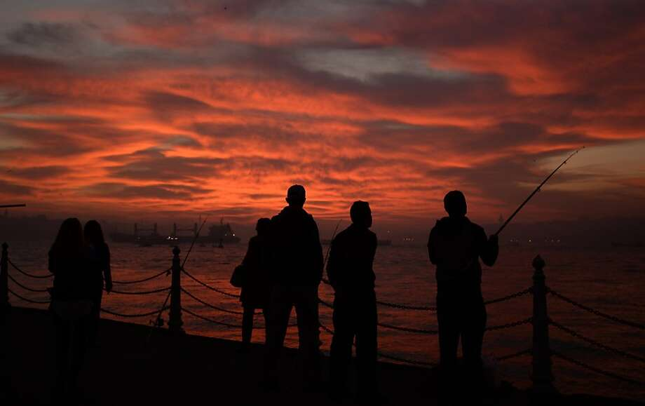 Fishermen try to get a few casts in before the sun sets on the Bosporus in Istanbul. Photo: Associated Press
