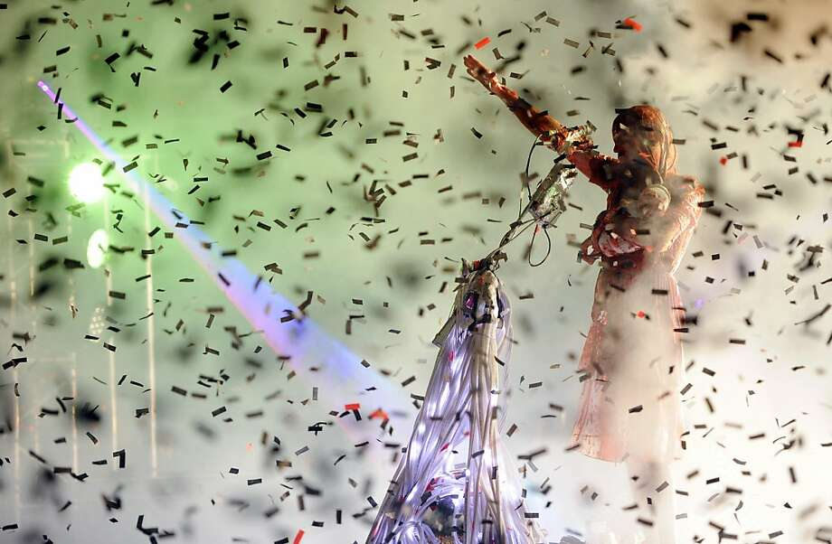 "Such an uplifting tune: Wayne Coyne of The Flaming Lips performs ""Halloween Blood Bath"" as confetti rains down at the  The Greek Theatre in Los Angeles. Photo: Chris Pizzello, Associated Press"
