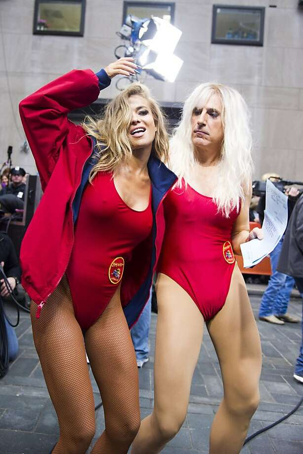 "It wouldn't be Halloween without horror costumes: Former ""Baywatch"" star Carmen Electra dances with Matt Lauer, dressed as Pamela Anderson's character C.J. Parker, on NBC's ""Today"" Halloween show in New York. Photo: Charles Sykes, Associated Press"