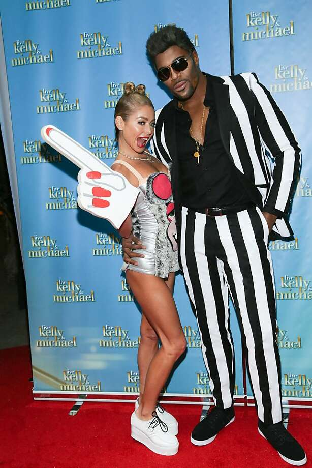 "Talk show twerkers:A couple claiming to be Miley Cyrus and Robin Thicke appear on ""LIVE With Kelly and Michael: Best Halloween Show Ever"" in New York City. Photo: Rob Kim, Getty Images"
