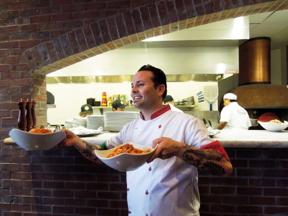 Tony Gemignani lifts big bowls of meatballs and pasta at the new Tony's of North Beach / Photos by SF Chronicle