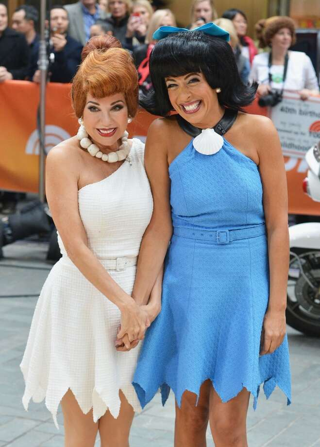 "Kathie Lee Gifford (L) and Hoda Kotb, dressed as Flintstone characters Wilma Flintstone and Betty Rubble, attend NBC's ""Today"" Halloween 2013 in Rockefeller Plaza on October 31, 2013 in New York City.  (Photo by Slaven Vlasic/Getty Images) Photo: Slaven Vlasic, Getty Images"